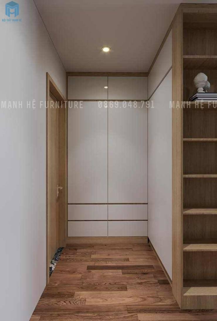 Tủ đồ gỗ công nghiệp màu trắng với nhiều ngăn nhỏ và lớn:  Phòng ngủ by Công ty TNHH Nội Thất Mạnh Hệ