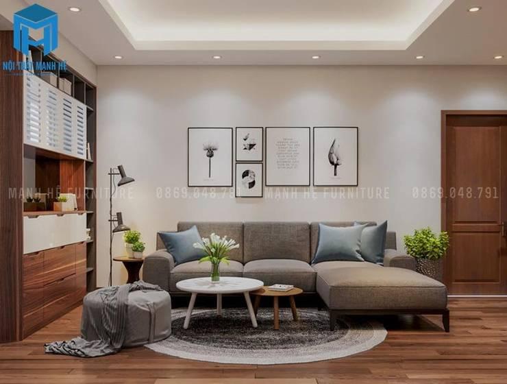Phòng khách khá trang nhã và lịch sự với bộ bàn ghế sofa nệm màu xám :  Phòng khách by Công ty TNHH Nội Thất Mạnh Hệ