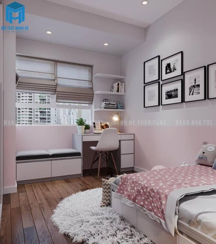 Phòng ngủ của bé gái được trang trí khá đơn giản :  Phòng ngủ nhỏ by Công ty TNHH Nội Thất Mạnh Hệ