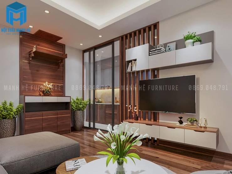 Phòng khách khá sang trọng và hiện đại:  Phòng khách by Công ty TNHH Nội Thất Mạnh Hệ