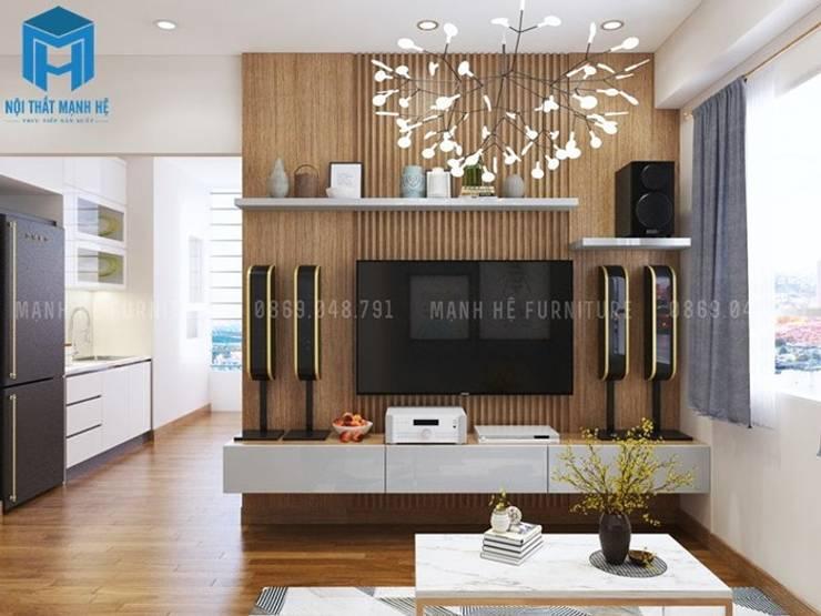 Nội thất phòng khách có vách ngăn bằng gỗ chống ẩm cao :  Phòng khách by Công ty TNHH Nội Thất Mạnh Hệ