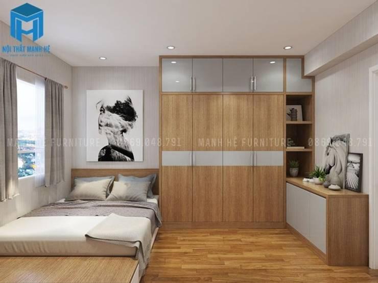 Nội thất phòng ngủ master với tủ đồ bằng gỗ có cây inox treo đồ:  Phòng ngủ by Công ty TNHH Nội Thất Mạnh Hệ