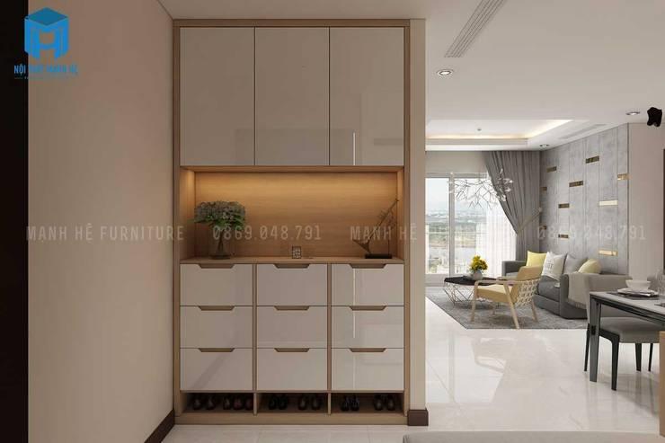 Tủ gỗ đưng đồ và giày dép đầy tiện ích:  Phòng khách by Công ty TNHH Nội Thất Mạnh Hệ