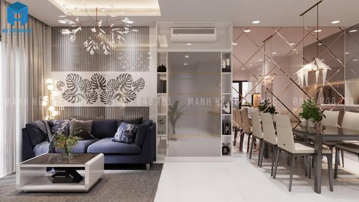 Vách bàn ăn bằng sơn tường màu xanh:  Phòng khách by Công ty TNHH Nội Thất Mạnh Hệ