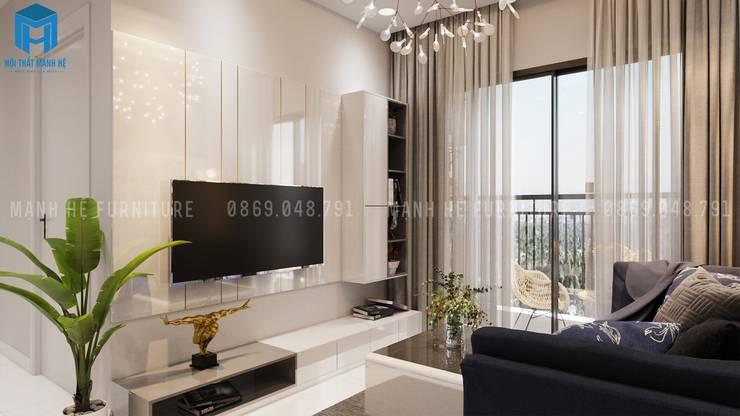 Tivi làm vách ốp nhìn sẽ đẹp và sang hơn:  Phòng khách by Công ty TNHH Nội Thất Mạnh Hệ