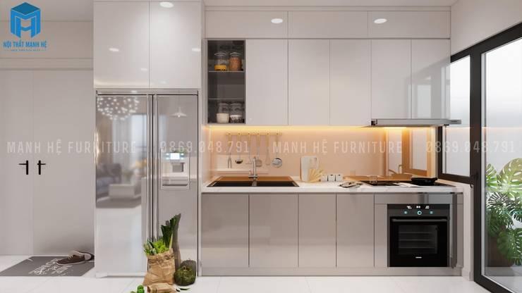 Tủ bếp chữ L tích hợp thiết bị bếp:  Phòng ăn by Công ty TNHH Nội Thất Mạnh Hệ