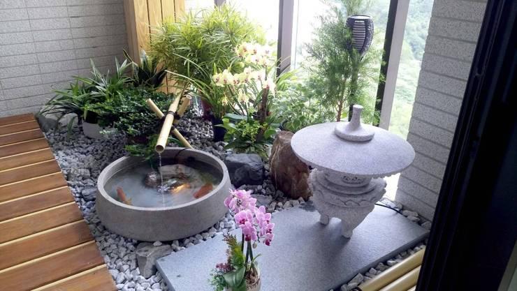 充滿日式禪風的陽台,搭配庭院燈飾:  禪風庭院 by 大地工房景觀公司