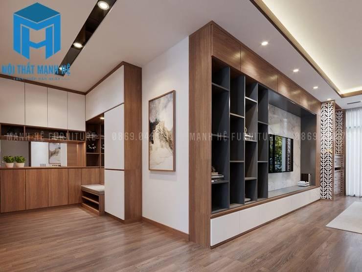 Hệ thống tủ, kệ gỗ tự nhiên nơi phòng khách:  Phòng khách by Công ty TNHH Nội Thất Mạnh Hệ