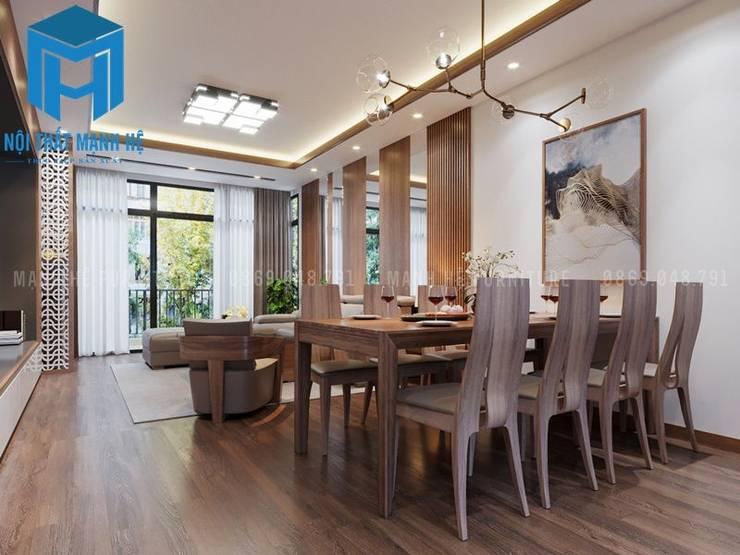 Phòng bếp và phòng khách liền kề nhau tạo nên sự liên kết khá hữu ích trong không gian của ngôi nhà:  Phòng ăn by Công ty TNHH Nội Thất Mạnh Hệ