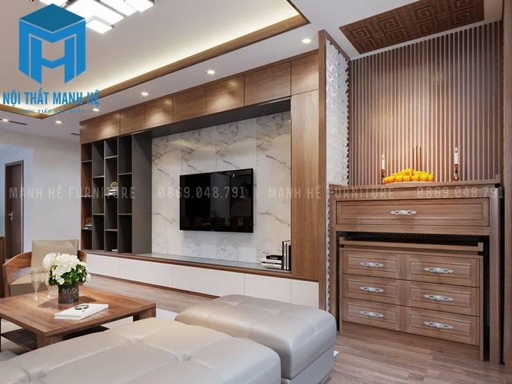 Tủ thờ được đặt nơi phòng khách:  Phòng khách by Công ty TNHH Nội Thất Mạnh Hệ