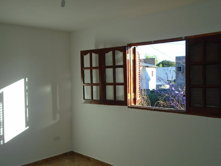 COMPLEJO DE DOS UNIDADES DE VIVIENDA: Dormitorios de estilo  por arq5912  Arquitectura y Construcción
