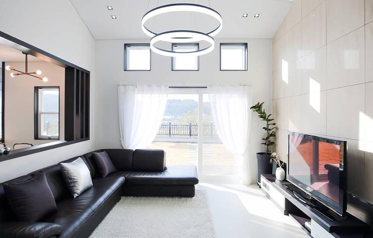 Salas de estilo  por 더존하우징