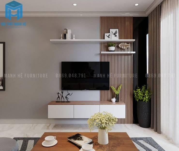 Kệ tivi được thiết kế khá nhỏ gọn và đơn giản:  Phòng khách by Công ty TNHH Nội Thất Mạnh Hệ