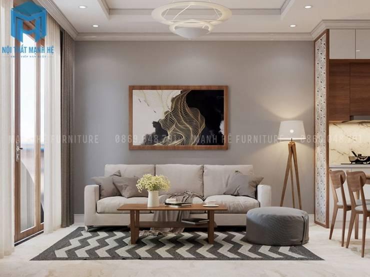Bộ ghế sofa nệm khung gỗ cùng chiếc bàn trà 4 chân đã tạo nên một không gian hiện đại và sang trọng:  Phòng khách by Công ty TNHH Nội Thất Mạnh Hệ