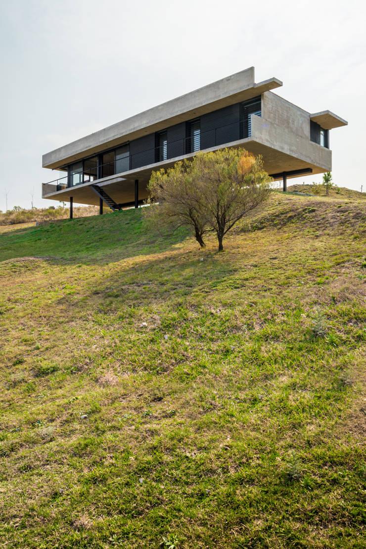 Casa en Los Molinos: Casas de estilo  por TECTUM,