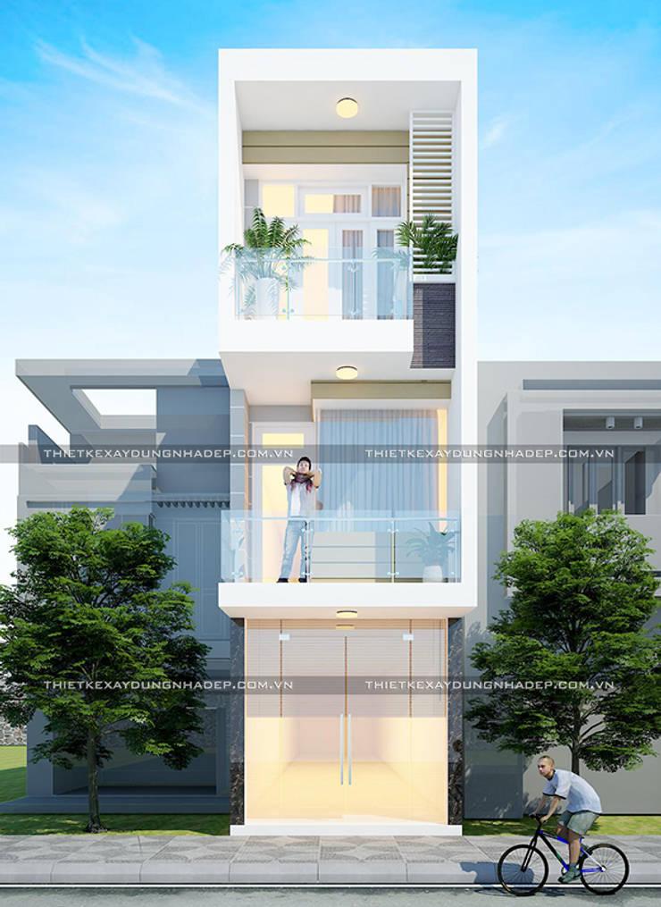 Mặt tiền nhà 3 tầng rộng 3m:  Nhà gia đình by Công ty cổ phần tư vấn kiến trúc xây dựng Nam Long
