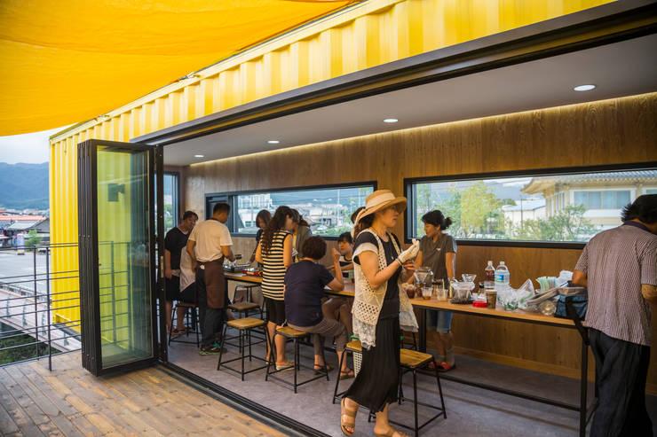 Salones de estilo  de 큐브디자인 건축사사무소