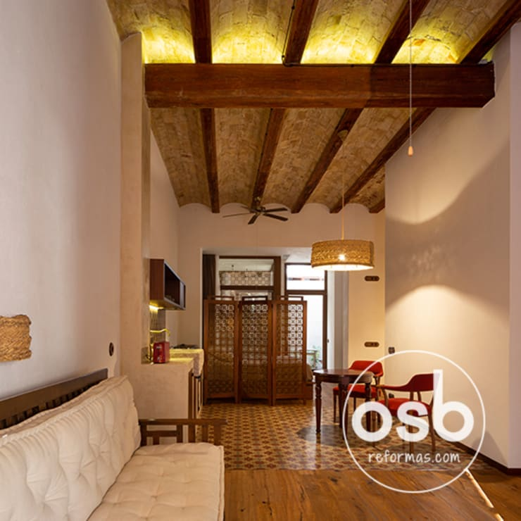 Rustic style dining room by osb arquitectos Rustic Wood Wood effect