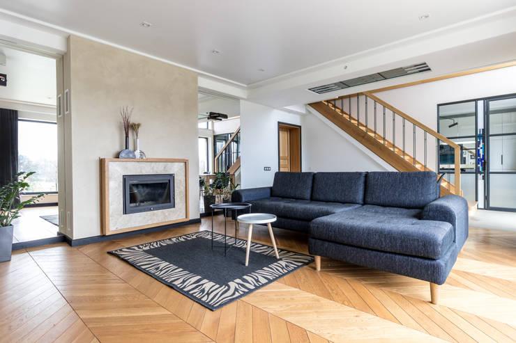 Living room by  Studio architecture and design LAD.Студия архитектуры и дизайна ЛАД .