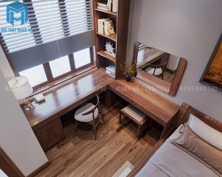 Bàn làm việc được thiết kế gắn liền với bàn trang điểm trong không gian phòng ngủ:  Phòng ngủ by Công ty TNHH Nội Thất Mạnh Hệ