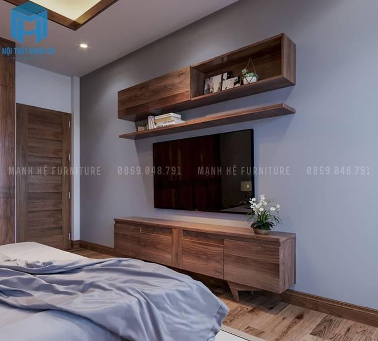Phòng ngủ được trang bị thêm bộ tủ tivi hình chữ nhật khá đơn giản và gọn nhẹ:  Phòng ngủ by Công ty TNHH Nội Thất Mạnh Hệ