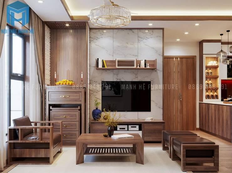 tủ tivi được đặt ngay bên cạnh tủ thờ trong không gian phòng khách:  Phòng khách by Công ty TNHH Nội Thất Mạnh Hệ