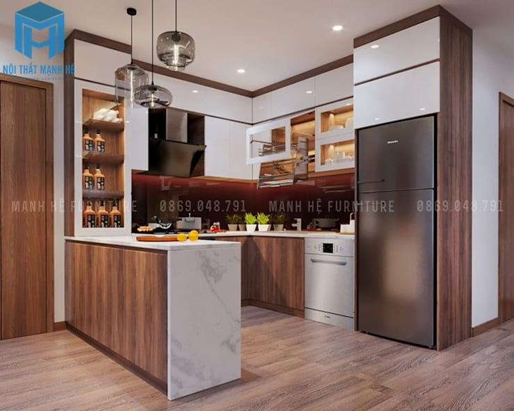 Hệ thống tủ bếp được thiết kế và bố trí khá chặt chẽ với nhau:  Phòng ăn by Công ty TNHH Nội Thất Mạnh Hệ
