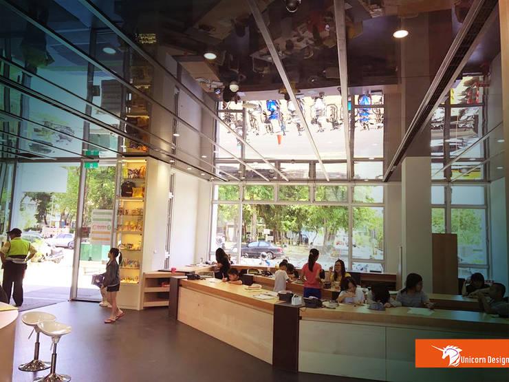 一樓大廳  老師辦公室:  商業空間 by Unicorn Design