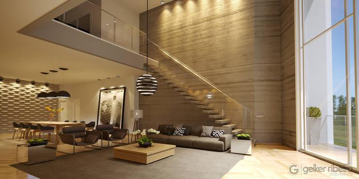 Sala Pé direito duplo, parede de concreto com escada engastada, iluminação : Paredes  por Gelker Ribeiro Arquitetura | Arquiteto Rio de Janeiro