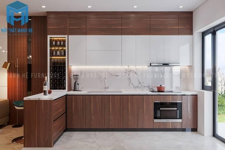 Tủ bếp hình chữ L khá hiện đại:  Phòng ăn by Công ty TNHH Nội Thất Mạnh Hệ