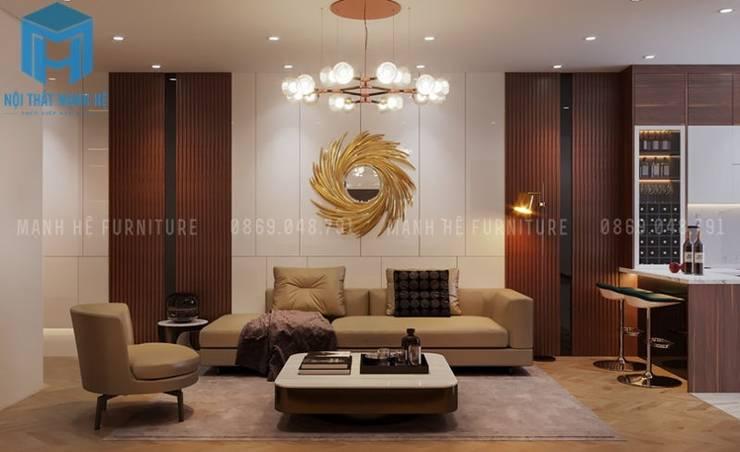 Bộ ghế sofa nệm khung gỗ màu vàng nhạt được đặt nhay trung tâm của căn phòng:  Phòng khách by Công ty TNHH Nội Thất Mạnh Hệ
