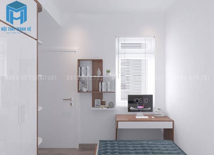 Bàn học cùng kệ sách treo tường được thiết kế khá kết nối với nhau:  Phòng ngủ nhỏ by Công ty TNHH Nội Thất Mạnh Hệ