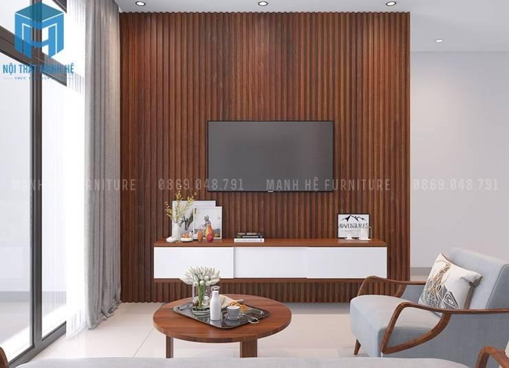 vách tường được ốp bằng gỗ tự nhiên khá hiện đại:  Phòng khách by Công ty TNHH Nội Thất Mạnh Hệ