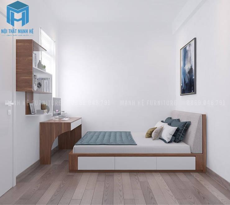 Phòng ngủ nhỏ với thiết kế khá đơn giản nhưng vẫn mang lại cho chủ nhân của căn phòng cảm giác tiện nghi:  Phòng ngủ nhỏ by Công ty TNHH Nội Thất Mạnh Hệ