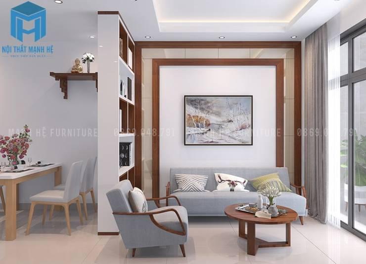 bộ ghế sofa nệm phòng khách khá sang trọng:  Phòng khách by Công ty TNHH Nội Thất Mạnh Hệ