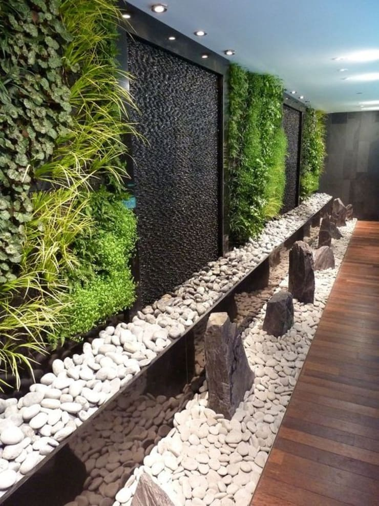FUENTE DE AGUA EN PIEDRA  DECORATIVA : Jardín de estilo  por AWA FUENTES