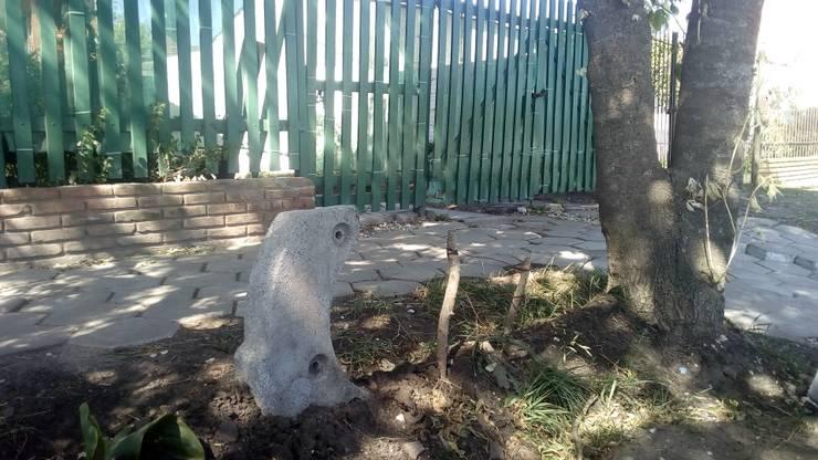 Tótem: Jardines con piedras de estilo  por DUSINSKY S.A.,