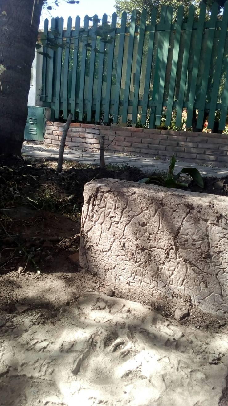 Huella 2: Jardines con piedras de estilo  por DUSINSKY S.A.,