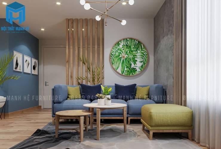 Bộ sofa phòng khách nổi bật cùng những vật dụng trang trí trong từng góc cạnh:  Phòng khách by Công ty TNHH Nội Thất Mạnh Hệ