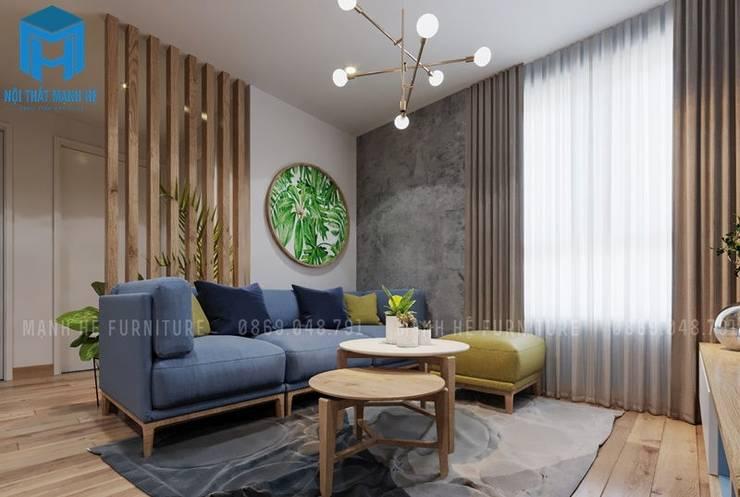 Cây xanh luôn được chú trọng trong toàn thể căn hộ  :  Phòng khách by Công ty TNHH Nội Thất Mạnh Hệ