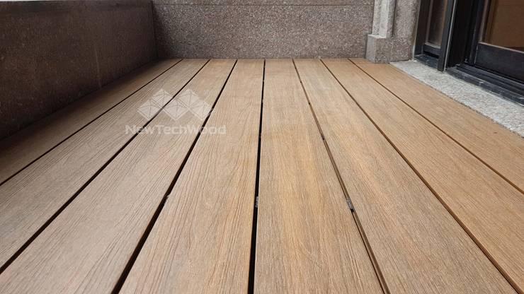 塑木鋪設─大樓陽台:  陽台 by 新綠境實業有限公司