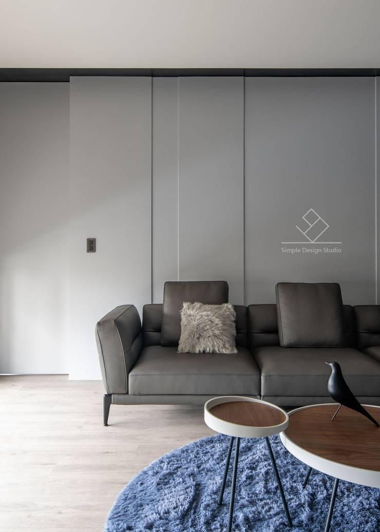 沙發背牆:  客廳 by 極簡室內設計 Simple Design Studio