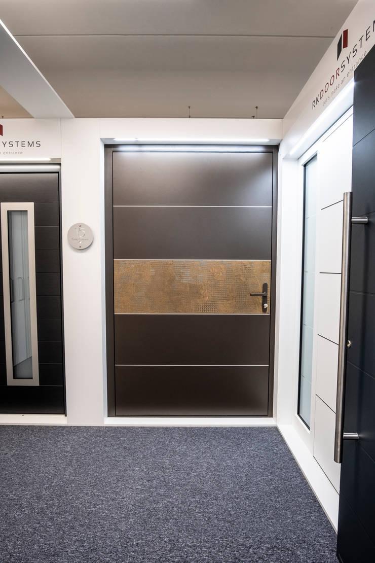 INTERNAL FINISH OF RK TEXTURED BRONZE FINISH PIVOT DOOR WITH METALLIC BROWN FRAME:  Doors by RK Door Systems,