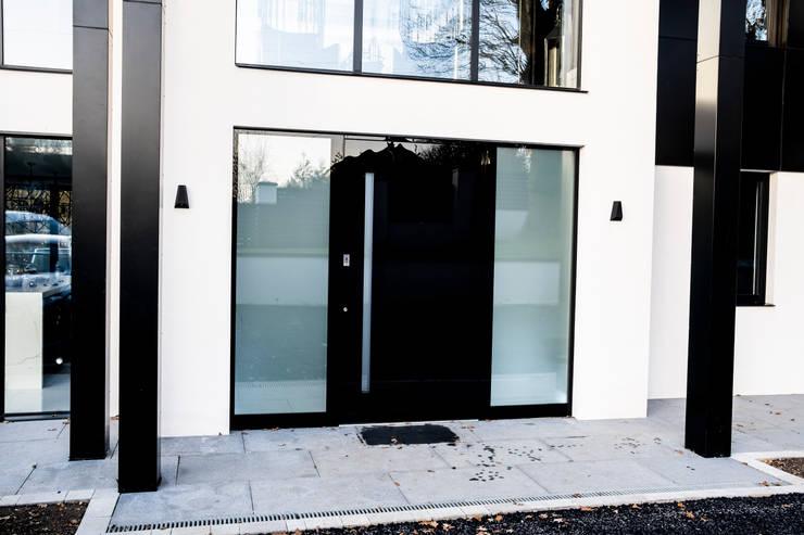 BLACK GLASS DOOR:  Doors by RK Door Systems,