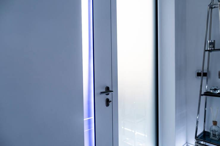 INTERNAL FINISH OF BLACK GLASS DOOR :  Doors by RK Door Systems,