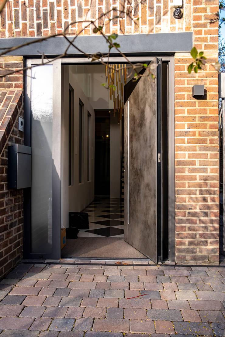 WINDY NICKEL SILVER PIVOT DOOR :  Doors by RK Door Systems,