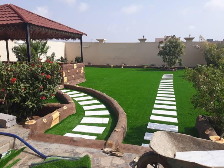 تنسيق الحدائق والعشب الصناعي والشلالات :   تنفيذ تنسيق الحدائق