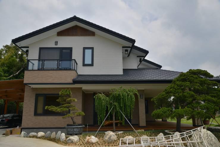 Casas ecológicas de estilo  por 翔霖營造有限公司,