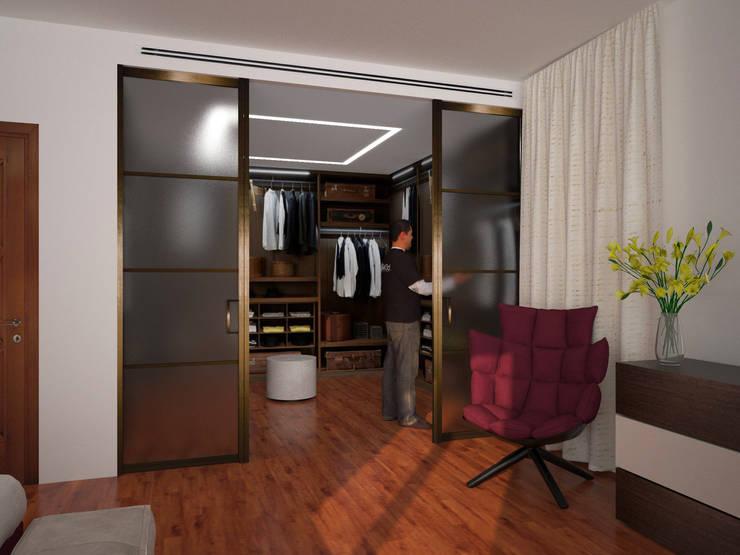 Cabina armadio: Spogliatoio in stile  di B+P architetti
