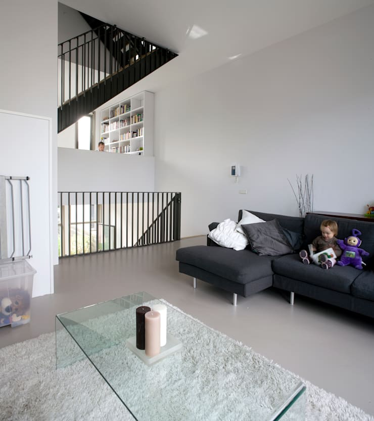 Salones de estilo moderno de TEKTON architekten Moderno